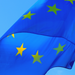 A picture of the EU flag waving.